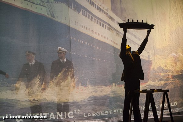 Marco D'Alberti holding aloft the model of the Titanic